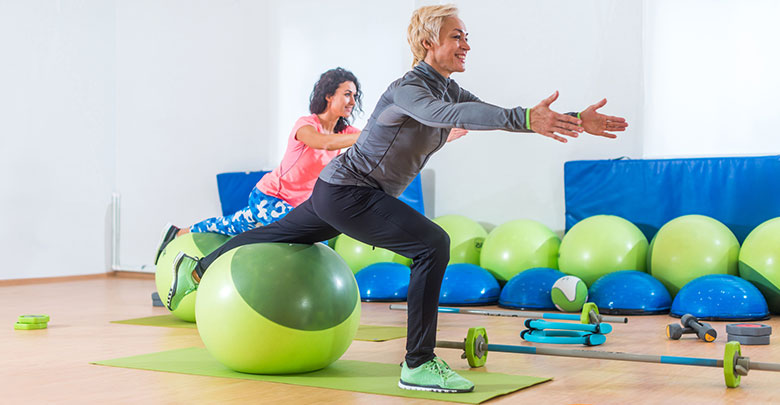 Two woman are doing Pilates ball work for their arthritis.