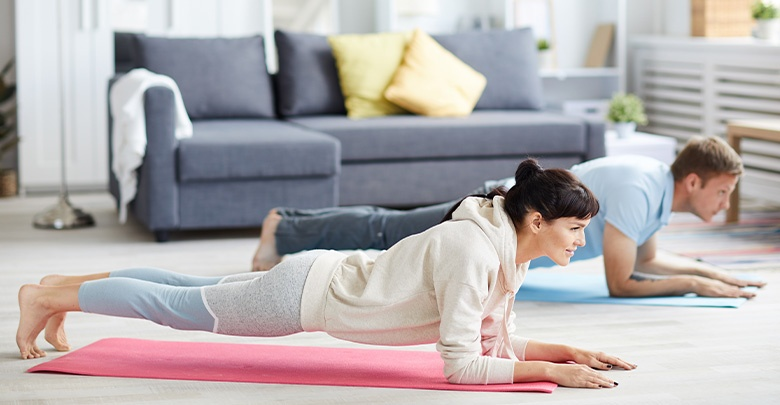 couple doing a plank at home